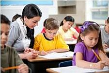 teacher-coaching-student-as-desk.tmb-medium